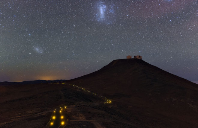 The Large Magellanic Cloud (middle left) and Small Magellanic Cloud (upper center) over Paranal Observatory in Chile. European Southern Observatory