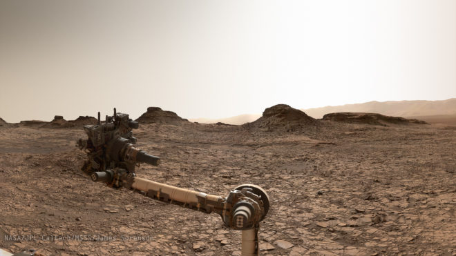 Curiosity arm at Murray buttes, in the Murray formation. The endless acres of mudstone are visible. (NASA/JPL-Malin & Edgett)