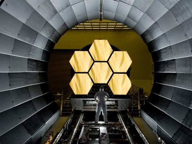 James Webb Space Telescope mirror being inspected at Goddard Space Flight Center, as it nears completion.  The powerful, sophisticated and long-awaited telescope is scheduled to launch in 2018.